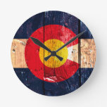 Distressed rustic wooden Colorado state flag Round Clocks