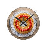 Frankfurt crown cake with cherries on rustic wood round clocks