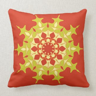 Green mandala on orange throw pillow
