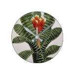 John Nugent Fitch - A plant flowering stem Round Clock