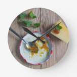 Onion pineapple chutney on rustic wood round wallclock