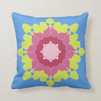 Pink green mandala on blue pillows