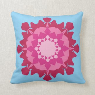Pink mandala on blue throw pillow