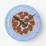 Russian chocolate cheesecake on a blue wooden back round wall clock