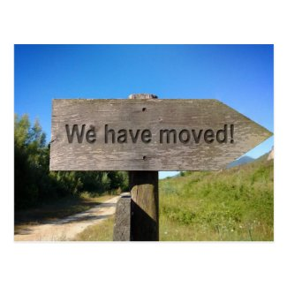 We have moved wooden sign postcard