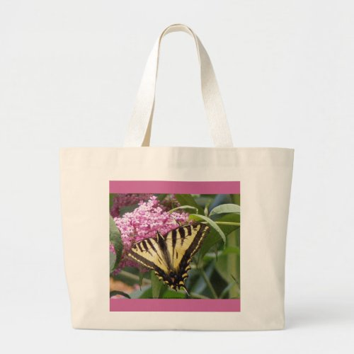 Western Tiger Swallowtail butterfly on pink lilacs bag