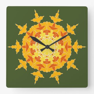 Yellow orange mandala on green square wall clock