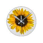 yellow sunflower on wood round clock