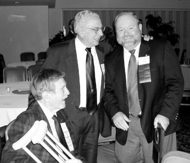 Earl Griffith, Dudley Bolyard and Randy Ray compare notes on being RMAG Past Presidents and Honorary Members.