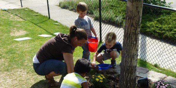 Tessa-Ms-Andrea-Brian-Aiden-planting