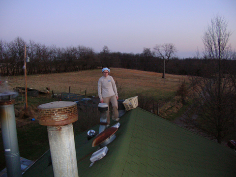 on the roof, installing a tubular skylight to get some natural light into the central bathroom