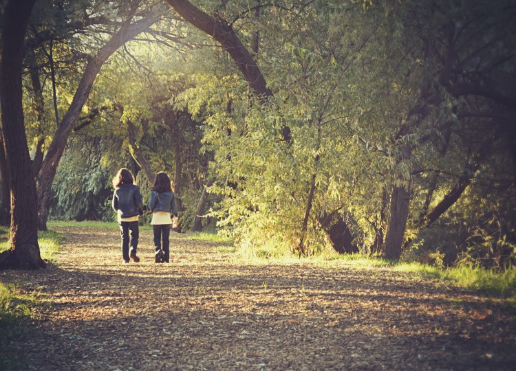 Sisters walking in the forest