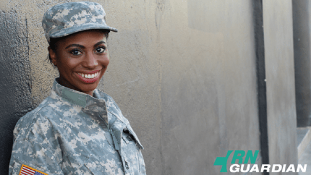 A woman in an Army uniform smiles.