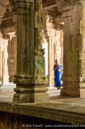 A local lady wanders through a quiet temple in Kanchipuram, Tamil Nadu, India.