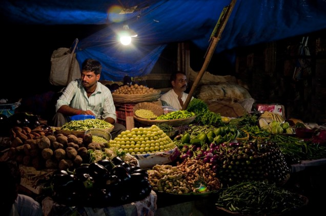 Vendors sit in silence waiting for customers at Parle Markets, Andheri India.