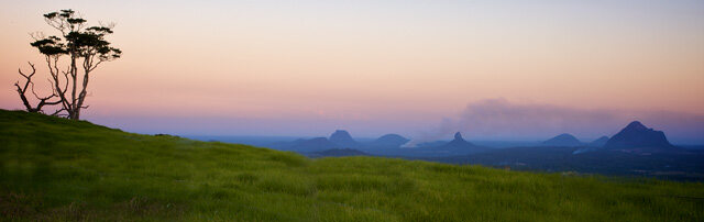 A tourism campaign image of the stunning Glass House Mountains