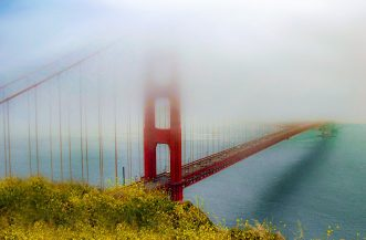 The shy Golden Gate bridge shrouded in fog, San Francisco, USA