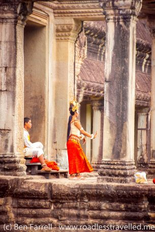 A traditional Khmer dancer prepares at Angkor Wat in Cambodia
