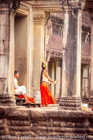 A traditional Khmer dancer prepares at Angkor Wat in Cambodia