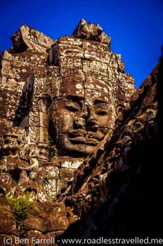 Buddha faces follow you as you walk around Angkor Wat in Cambodia