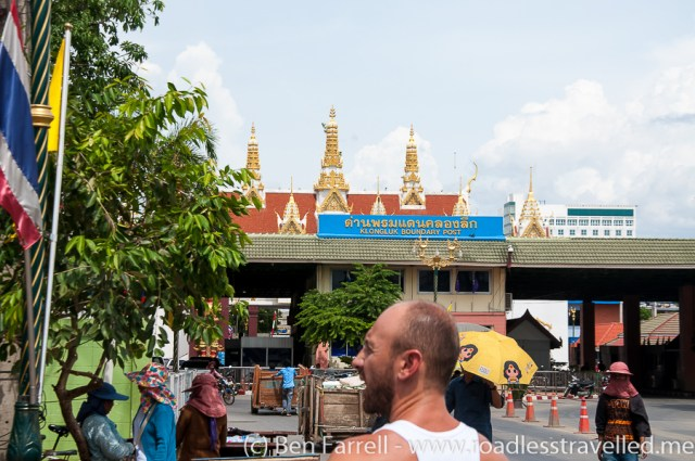 What the border looks like once you step off the bus. Walk straight towards the building with the temple spires and stay on the left