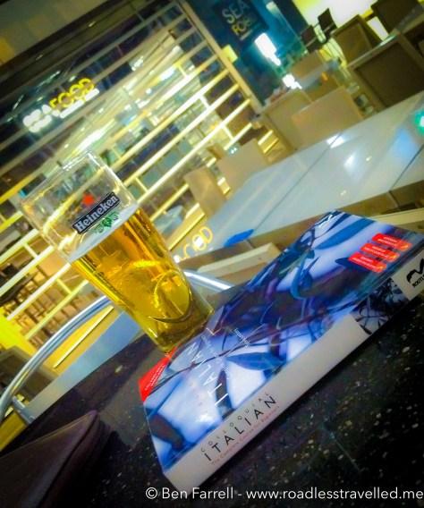 Having a beer & brushing up on my Italian in the terminal bar at Hong Kong Airport