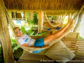 Relaxing in a hammock in our beach hut