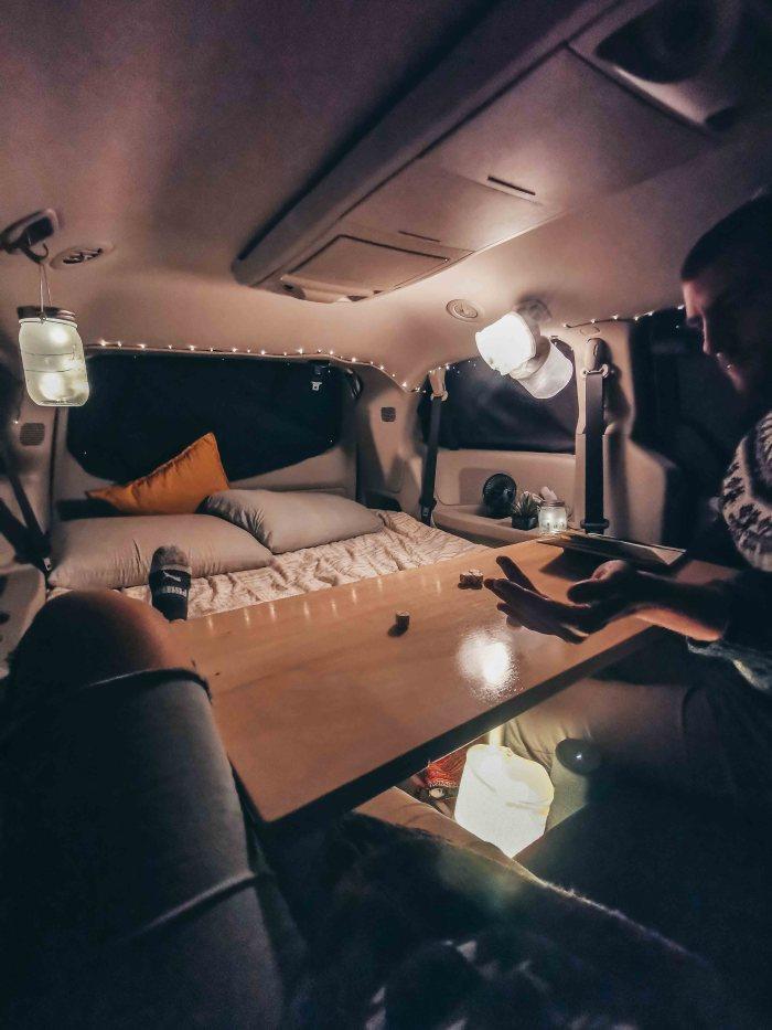 Table inside minivan camper conversion kit