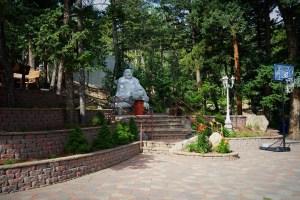 statue of Buddha on stone platform