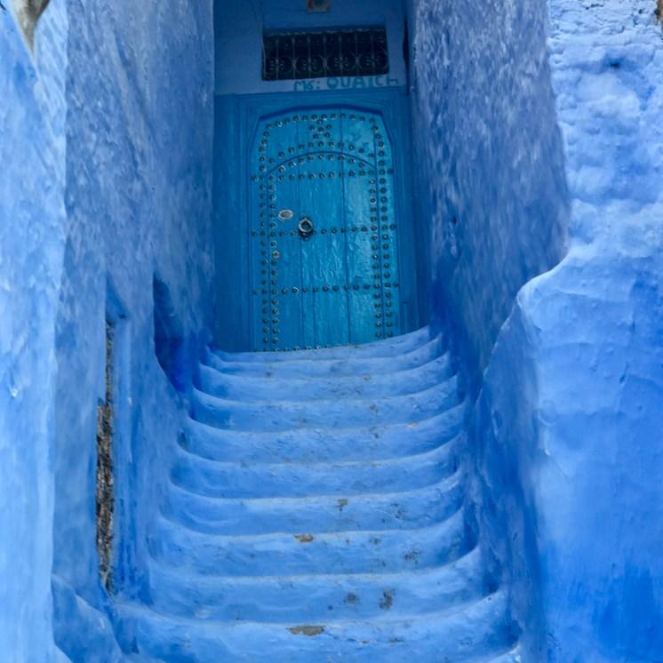 Blue Stairway to cool blue door
