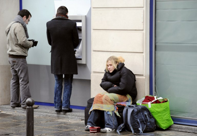 Homeless woman in Paris