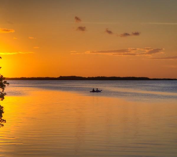 Girls Kayaking at Sunset