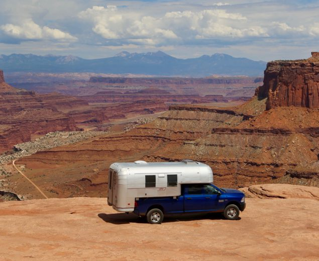 1970 Avion C11 truck camper parked on overlook in Canyonlands National Park