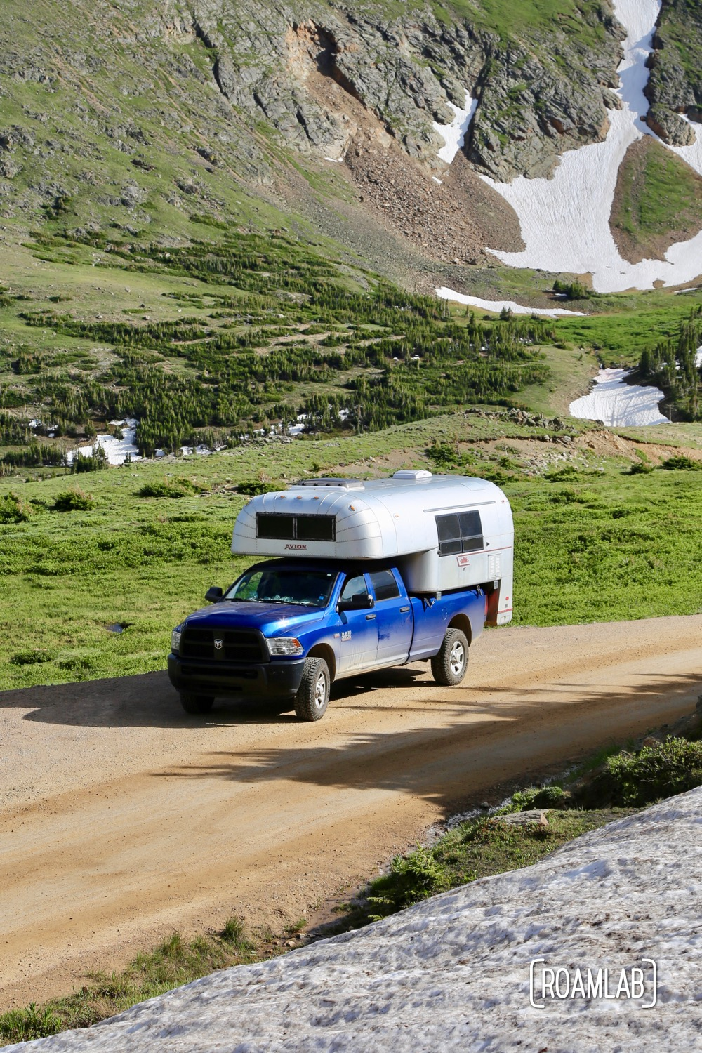1970 Avion C11 Truck Camper driving among the glaciers on Old Fall River Road in Rocky Mountains National Park