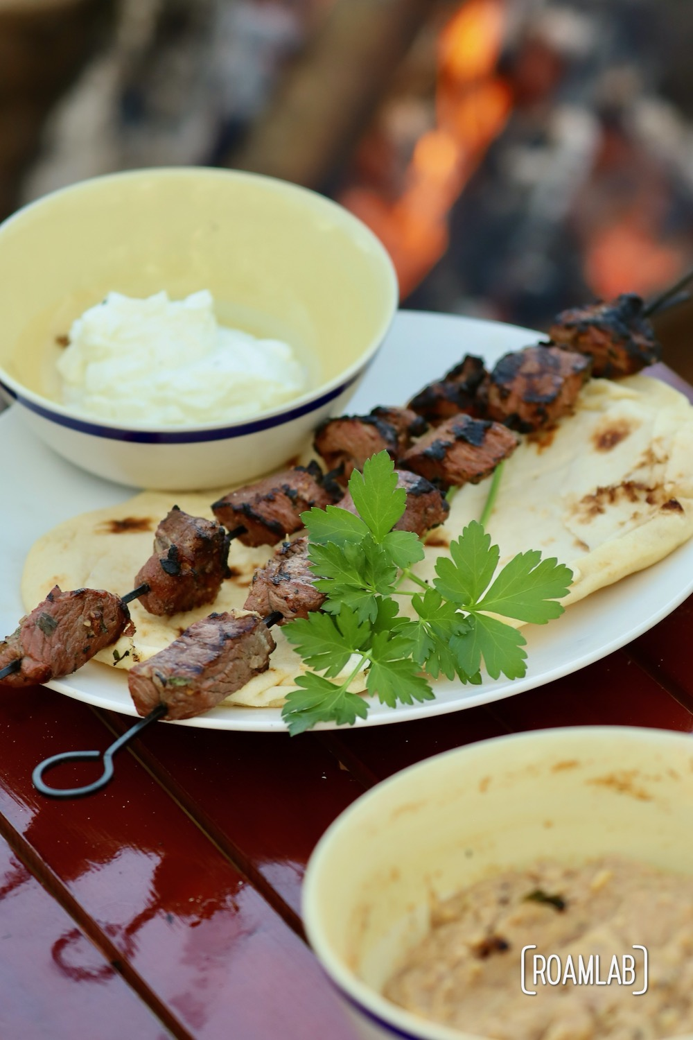 Grill this savory middle eastern Lamb Kabob campfire cooking dinner recipe with a side of toasted pita bread and yogurt for a delicious al fresco meal.