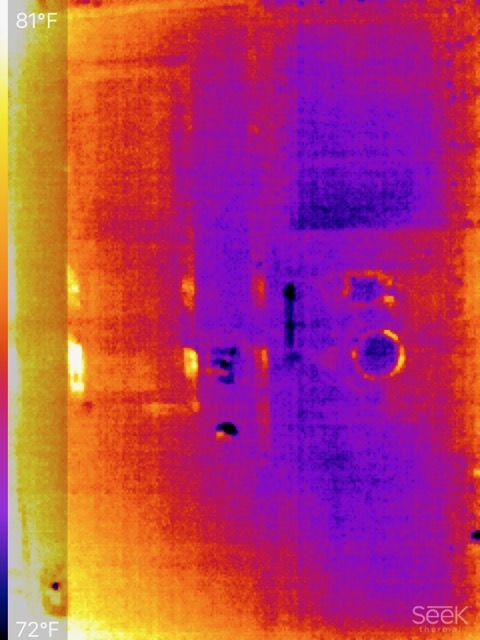 Thermal image of truck camper rear exterior with Seek watermark in lower right-hand corner