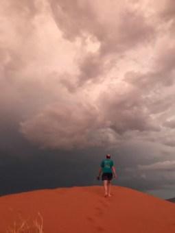 Matt walking towards the desert storm.