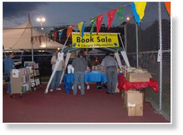 A photo of later that night with the Roanoke Public Library's booth in full swing.