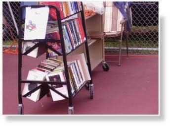A photo of the book carts refilled with the used books ready for sale.