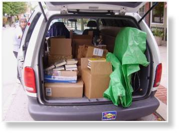 A photo of loading up a van to transport used books to the Festival