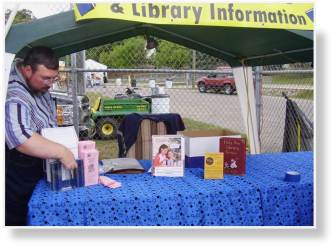 A photo of putting and arranging items of Library information on the table.