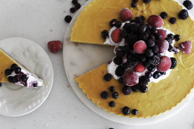 Lemon and Cashew Vegan Raw Cheesecake with slice taken out of it