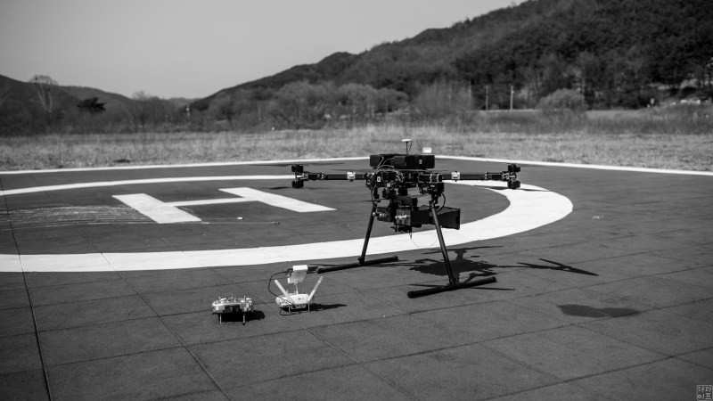 A drone catcher drone with built-in drone jammer
