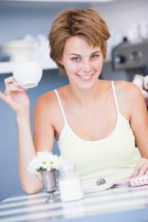 Woman enjoying delicious cup of coffee