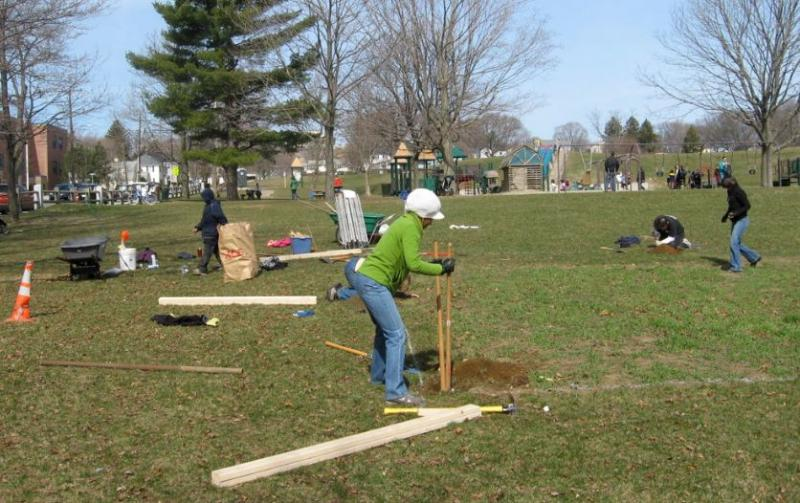 Misrak digging a fence post hole