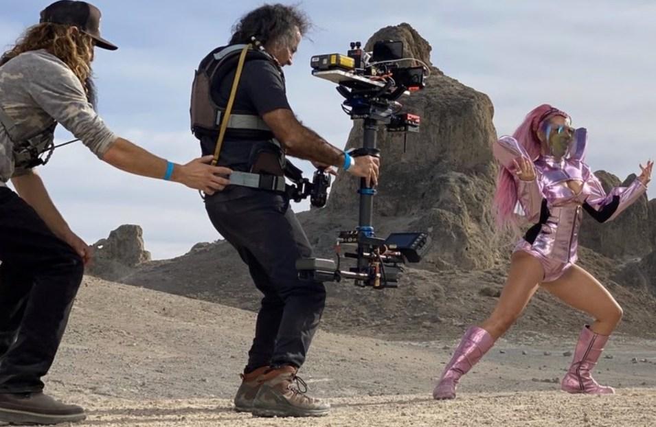 Camera operator filming Lady Gaga