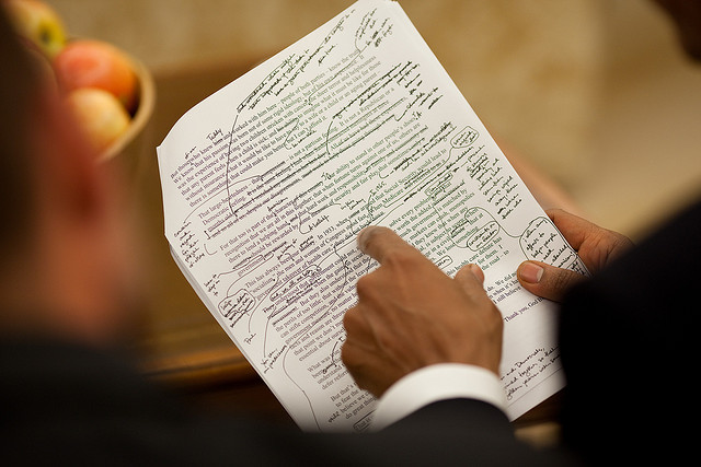 President Obama reviews a speech with Jon Favreau