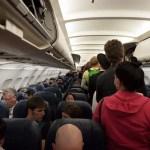 vomit on plane arrested