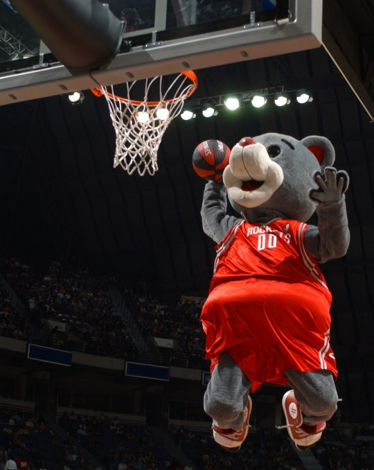 MEMPHIS - FEBRUARY 20: Houston Rockets mascot Clutch dunks during an intermission in the game between the Memphis Grizzlies and the Phoenix Suns at The Pyramid on February 20, 2004 in Memphis, Tennessee. The Grizzlies won 97-92. NOTE TO USER: User expressly acknowledges and agrees that, by downloading and or using this photograph, User is consenting to the terms and conditions of the Getty Images License Agreement. (Photo by Joe Murphy/NBAE via Getty Images)