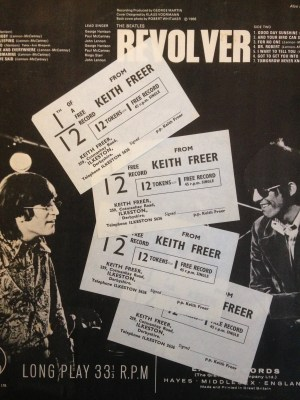 Record tokens on Revolver's back cover.